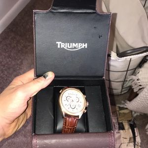 Triumph gold and sapphire watch